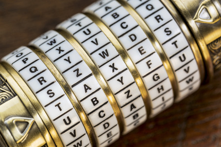 taxes word as a password to combination puzzle box with rings of letters Banco de Imagens