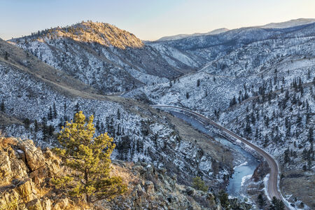 fort collins: Cache la Poudre River Canyon and Colorado highway 14 - a winter view from Gateway Natural Area near Fort Collins