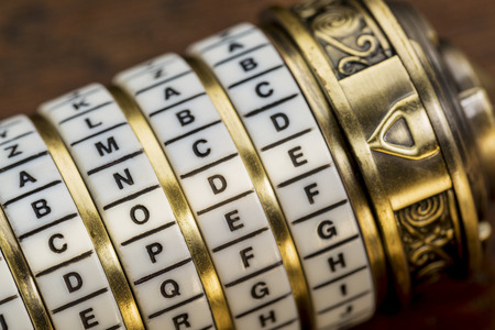 secret code: code word as a password to combination puzzle box with rings of letters