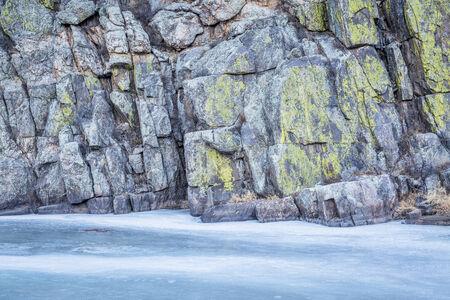 cache la poudre river: frozen river and canyon wall covered by lichen - Cache la Poudre River at Gateway near Fort Collins, Colorado