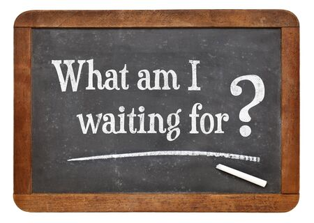 procrastination: What am I waiting for? A question on a vintage slate blackboard.