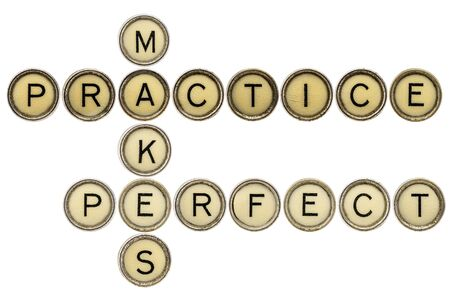 practice makes perfect croosword in old round typewriter keys isolated on white photo