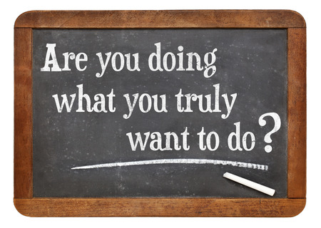 Are you doing what you truly want to do? A question on a vintage slate blackboard 版權商用圖片