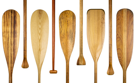 grip: blades and grips of  wooden canoe paddles, a variety of styles and shapes - paddling concept