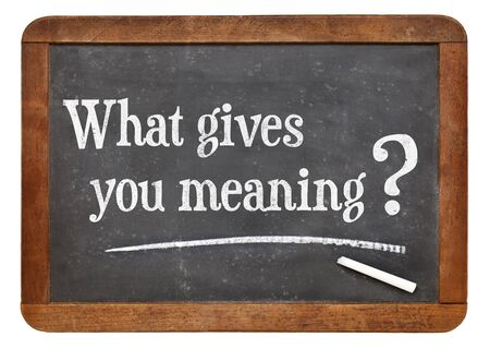 What gives you meaning ? A question on a vintage slate blackboard Stock Photo