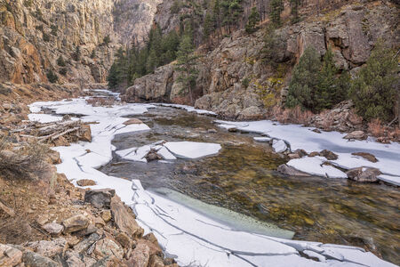 fort collins: Cache la Poudre River at Big Narrows west of  Fort Collins in northern Colorado - winter scenery with a partially frozen river