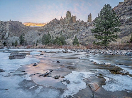 cache la poudre: winter dusk over canyon of Cache la Poudre River above Little Narrows west of Fort Collins in northern Colorado