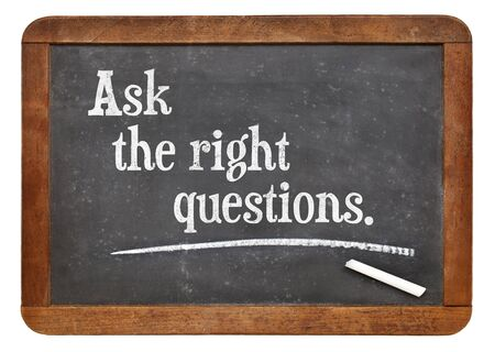 right ideas: Ask the right questions  - motivational advice on a vintage slate blackboard