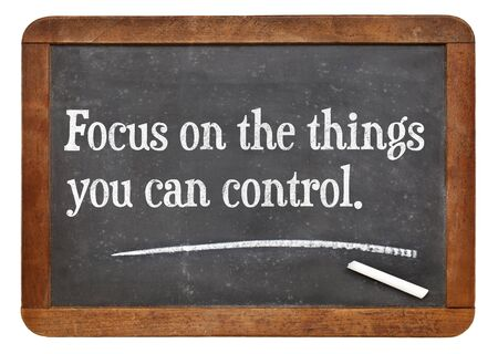 Focus on the things you can control - motivational advice on a vintage slate blackboard