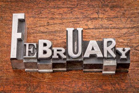 February word in mixed vintage metal type printing blocks over grunge wood photo