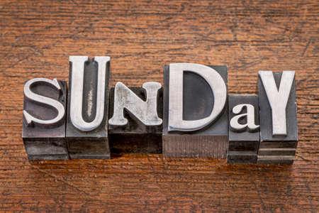 Sunday word in mixed vintage metal type printing blocks over grunge wood photo