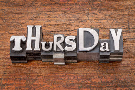 thursday: Thursday word in mixed vintage metal type printing blocks over grunge wood