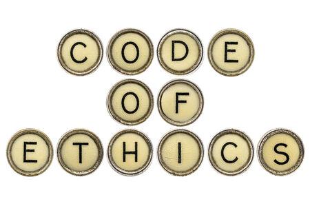 etica: código de ética de texto en llaves antiguas máquinas de escribir redondos aislados en blanco Foto de archivo