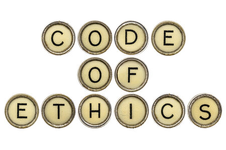 ethics: code of ethics text  in old round typewriter keys isolated on white