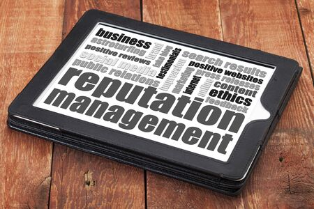 reputation: reputation management word cloud on adigital tablet tablet against red wood