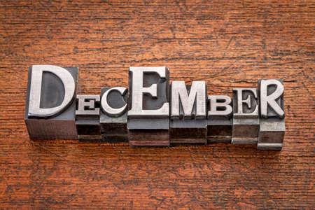 December  word in mixed vintage metal type printing blocks over grunge wood photo