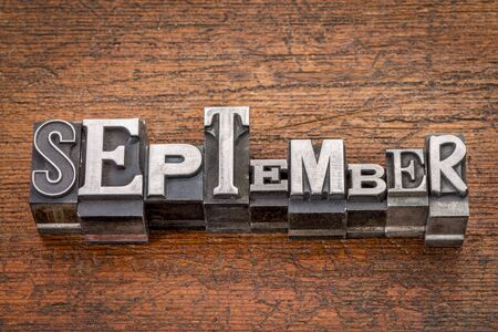 September word in mixed vintage metal type printing blocks over grunge wood photo