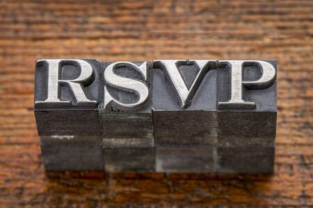 rsvp acronym i(request for a response from the invited person) n mixed vintage metal type printing blocks over grunge wood