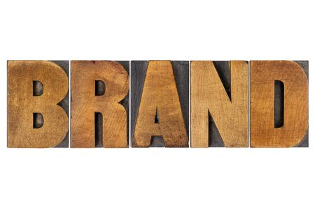wood type: brand word in isolated letterpress wood type printing blocks Stock Photo