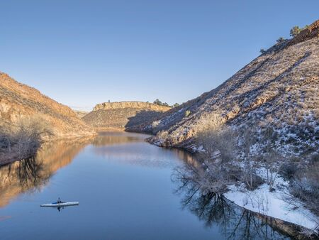 horsetooth reservoir: aerial view of canoe on Horsetooth Reservoir near Fort Collins, Colorado, winter scenery with some snow