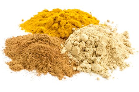 piles of three healthy spices -turmeric, ginger and cinnamon Banco de Imagens