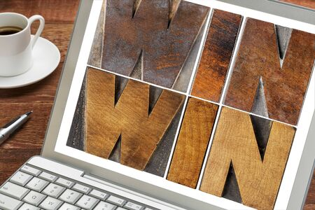 resolution: win-win - negotiation or conflict resolution strategy  -  words in letterpress wood type on a laptop screen with a cup of coffee