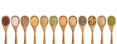 pinto bean: beans, lentils and pea - a collection of food ingredient on isolated wooden spoons Stock Photo