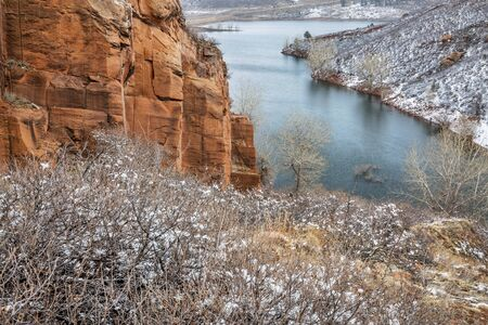 horsetooth rock: Old sandstone quarry on the shore of Horesetooth Reservoir near Fort Collins, Colorado, winter scenery with snow falling Stock Photo