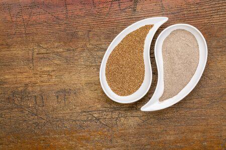 teardrop: gluten free teff grain and flour in teardrop shaped bowls against grunge wood