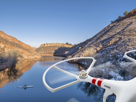 horsetooth reservoir: quadcopter drone flying over lake with a canoe - Horsetooth Reservoir near Fort Collins, Colorado Stock Photo