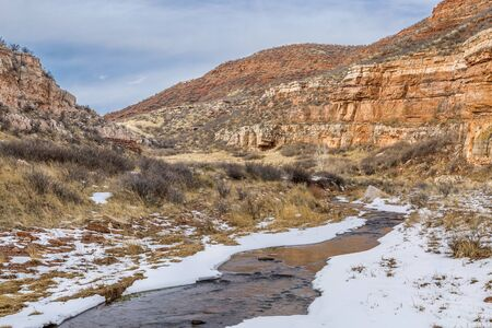 red mountain open space: stream in sandstone canyon - Sand Creek in Red Mountain Open Space near Fort Collins, Colorado, winter scenery
