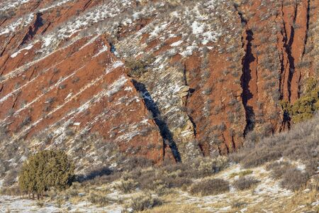 red mountain open space: layers of red sandstone rock - winter scenery in Red Mountain Open Space near Fort Collins, Colorado
