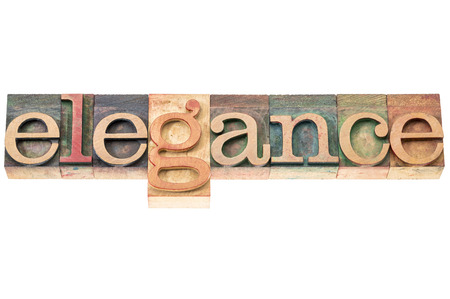 wood type: elegance word typography - isolated text in letterpress wood type blocks Stock Photo