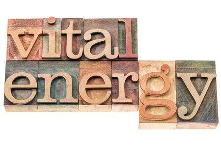 vital: vital energy typography - isolated text in letterpress wood type blocks