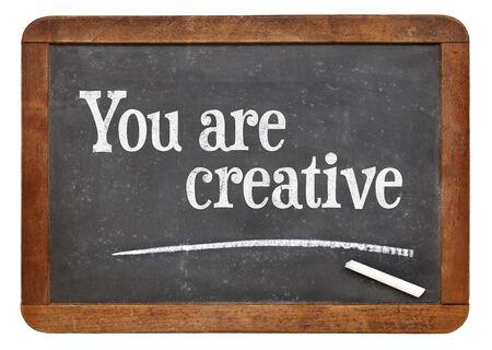 affirmation: You are creative - positive affirmation words on a vintage slate blackboard