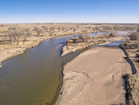 aerial view of South Platte River in eastern Colorado below Platteville, a typical winter scenery with exposed sandbars
