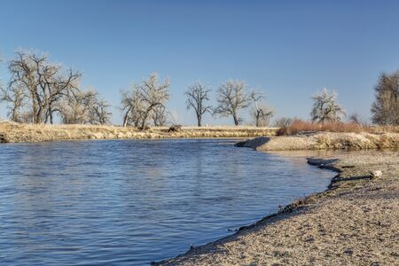 South Platte River in eastern Colorado below Platteville, a typical winter scenery with exposed sandbars Stock Photo