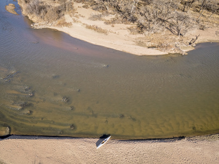 south platte river: aerial view of South Platte River in eastern Colorado below Platteville with a canoe on sandbar, a typical winter scenery with a low flow Stock Photo