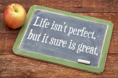 Life is not perfect, but it sure is great w - positive words on a slate blackboard against red barn wood