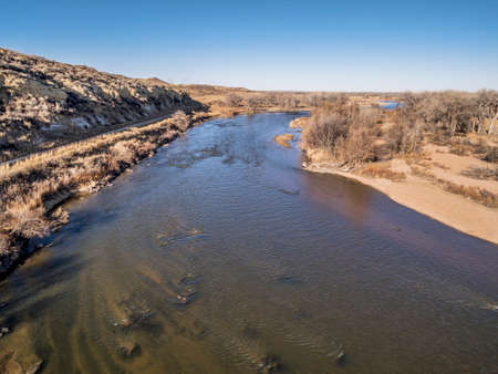 south platte river: aerial view of South Platte River at Wildcat Mound in eastern Colorado below Platteville, a typical winter scenery with exposed sandbars and rock garden