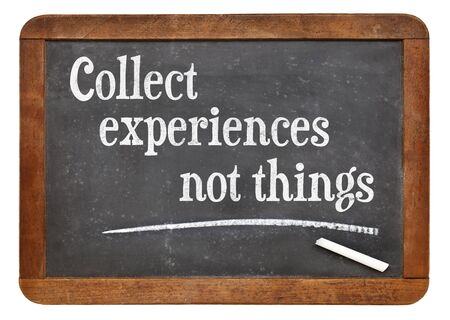 Collect experiences not things - words of inspiration on a vintage slate blackboard