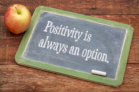 positivity: Positivity is always an option - text  on a slate blackboard against red barn wood