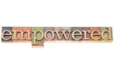 empowered: empowered word typography - isolated text in letterpress wood type Stock Photo