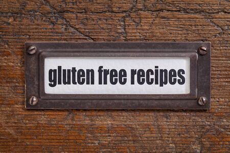 gluten free recipes - file cabinet label, bronze holder against grunge and scratched wood