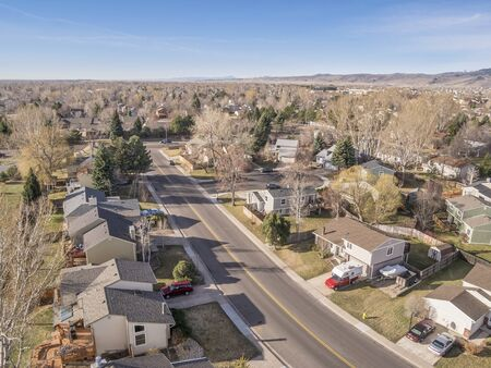 fort collins: FORT COLLINS, CO, USA - MARCH 16, 2015: Aerial view of typical residential neighborhood along Front Range of Rocky Mountains in Colorado,  early spring