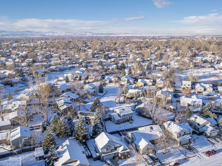 FORT COLLINS, CO, USA - December 28 2014: Aerial view of typical residential neighborhood along Front Range of Rocky Mountains in Colorado, winter scenery shot from a low flying drone