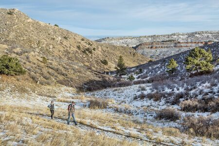 fort collins: FORT COLLINS, CO, USA - January 6, 2015:  A young couple hiking in Horsetooth Mountain Park, a popular recreation area near Fort Collins in northern Colorado