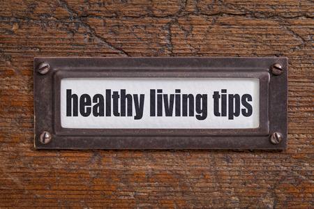 healthy living tips  - file cabinet label, bronze holder against grunge and scratched wood