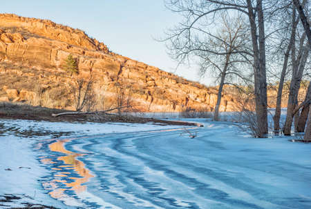 horsetooth reservoir: sandstone cliff and frozen lake - Horsetooth Reservoir in Fort Collins, Colorado Stock Photo