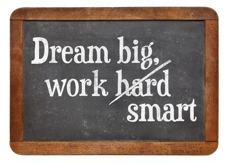 Dream big, work smart.  Motivational words on a vintage slate blackboard Zdjęcie Seryjne